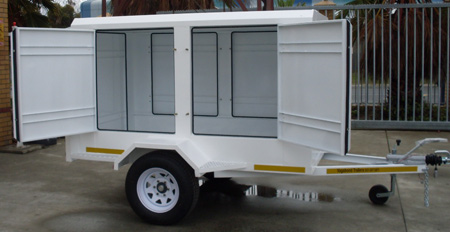 Exhibition trailer with swing open side and rear doors